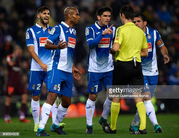 Espanyol players argue Ricardo de Burgos Bengoetxea the referee after he awards a penalty against them during the Copa Del Rey 1st leg match between...