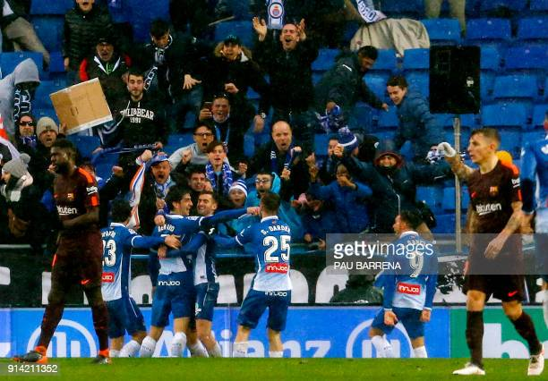 Espanyol players celebrate a goal during the Spanish league football match between RCD Espanyol and FC Barcelona at the RCDE Stadium in Cornella de...