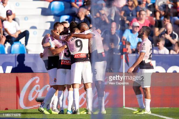 Espanyol players celebrate after Bernardo Espinosa scored the opening goal during the La Liga match between Levante UD and RCD Espanyol at Ciutat de...