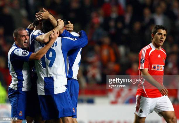 Espanyol players celebrate as Katsouranis of Benfica looks dejected during the UEFA Cup quarter final second leg match between Benfica and Espanyol...