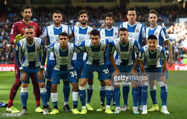 Espanyol players line-up for a group photograph before the start of the Liga match between Real Madrid CF and RCD Espanyol at Estadio Santiago...