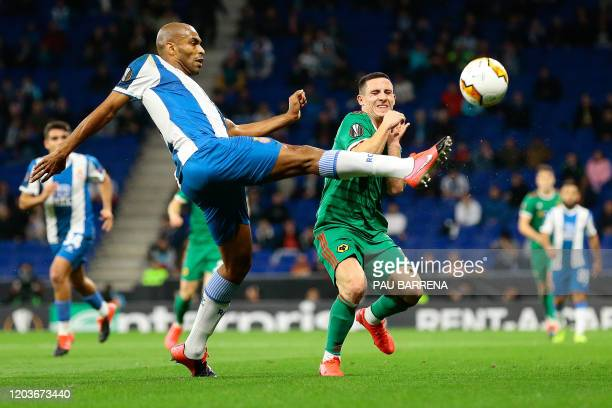 Espanyol's Brazil defender Naldo vies with Wolverhampton Wanderers' Portuguese forward Daniel Podence during the UEFA Europa League round of 32...