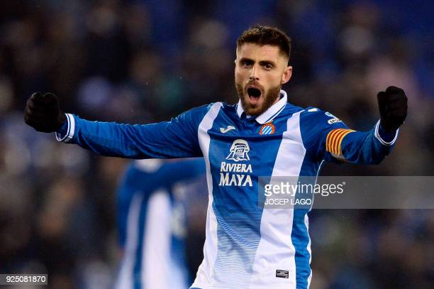 Espanyol's captain Spanish midfielder David Lopez celebrates his team's win at the end of the Spanish league football match between RCD Espanyol and...