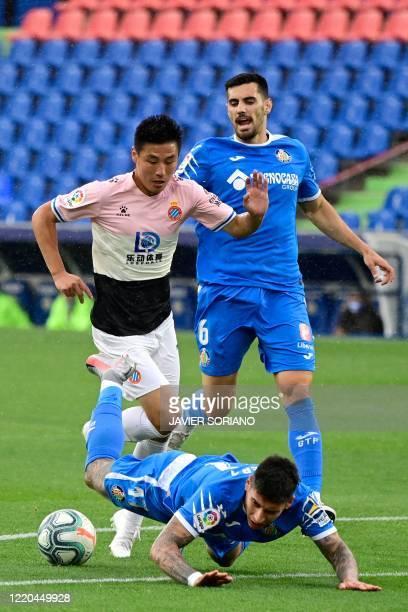 Espanyol's Chinese forward Wu Lei challenges Getafe's Uruguayan defender Mathias Olivera during the Spanish league football match Getafe CF against...