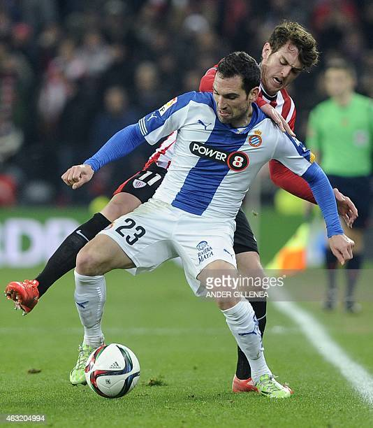 Espanyol's defender Anaitz Arbilla vies with Athletic Bilbao's forward Ibai Gomez during the Spanish Copa del Rey semifinal first leg football match...