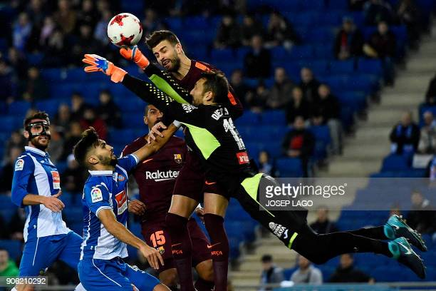 TOPSHOT Espanyol's defender Didac Vila and Espanyol's goalkeeper Diego Lopez vie with Barcelona's defender Gerard Pique during the Spanish 'Copa del...