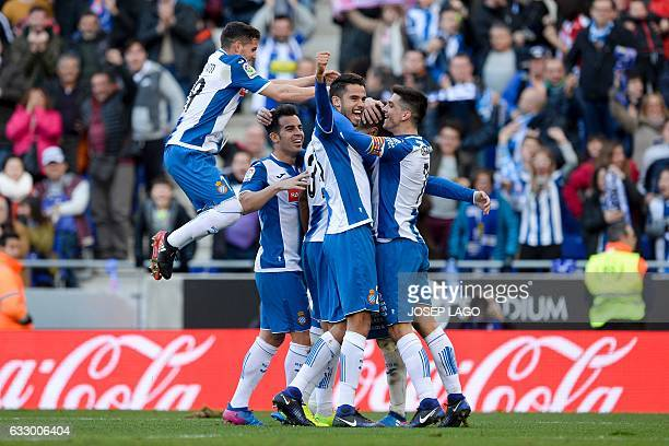 Espanyol's defender Marc Navarro celebrates a goal with teammates during the Spanish league football match RCD Espanyol vs Sevilla FC at the...