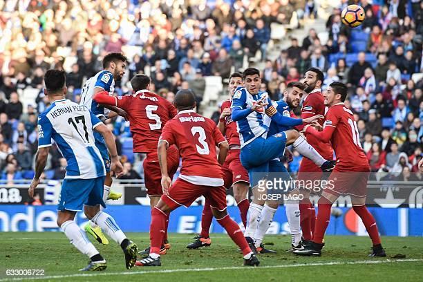Espanyol's defender Marc Navarro heads the ball to score a goal during the Spanish league football match RCD Espanyol vs Sevilla FC atthe CornellaEl...