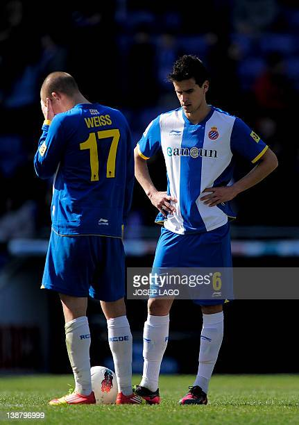 Espanyol's Eslovakian midfielder Vladimir Weiss and Espanyol's Portuguese forward Rui Fonte react during the Spanish league football match RCD...
