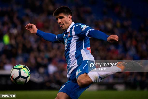 Espanyol's forward Gerard Moreno shoots the ball during the Spanish league football match RCD Espanyol vs Villarreal CF on February 18 2018 at the...
