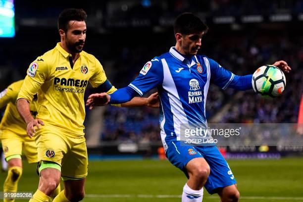 Espanyol's forward Gerard Moreno vies with Villarreal's Spanish defender Mario during the Spanish league football match RCD Espanyol vs Villarreal CF...