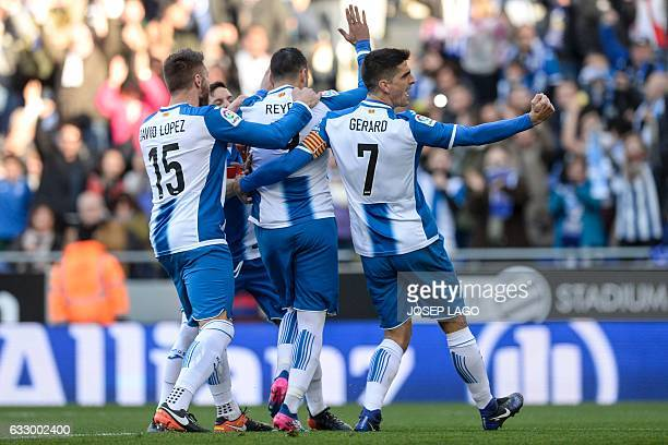 Espanyol's midfielder Jose Antonio Reyes is congratulated by teammates after scoring a goal during the Spanish league football match RCD Espanyol vs...