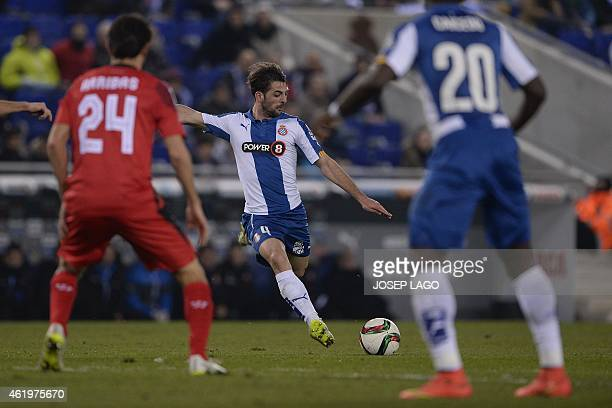 Espanyol's midfielder Victor Sanchez shoots a ball during the Spanish Copa del Rey quarter final first leg football match RCD Espanyol vs Sevilla FC...