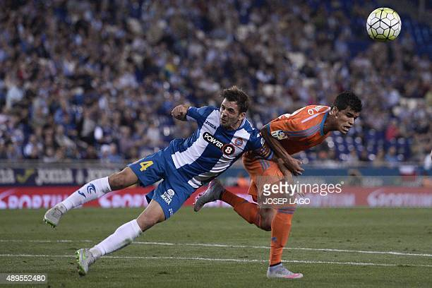 Espanyol's midfielder Victor Sanchez vies with Valencia's Salvadorean midfielder Danilo during the Spanish league football match RCD Espanyol vs...