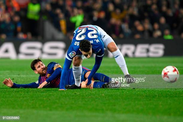 Espanyol's Spanish defender Mario Hermoso fouls Barcelona's Argentinian forward Lionel Messi during the Spanish 'Copa del Rey' quarterfinal second...