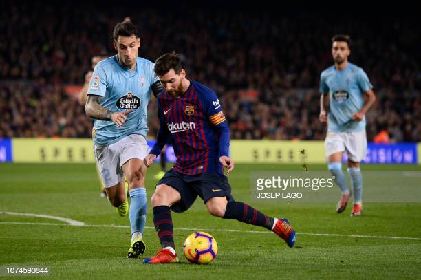 Espanyol's Spanish defender Pipa vies with Barcelona's Argentinian forward Lionel Messi during the Spanish League football match between FC Barcelona...