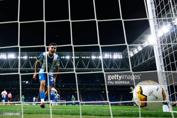 Espanyol's Spanish defender Victor Perea reacts after Wolverhampton Wanderers' Maliense forward Adama Traore scored during the UEFA Europa League...