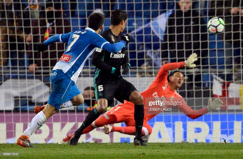 Espanyol's Spanish forward Gerard Moreno (L) scores a goal during the Spanish league football match between RCD Espanyol and Real Madrid CF atthe RCDE Stadium in Cornella de Llobregat on February 27, 2018. / AFP PHOTO / Josep LAGO