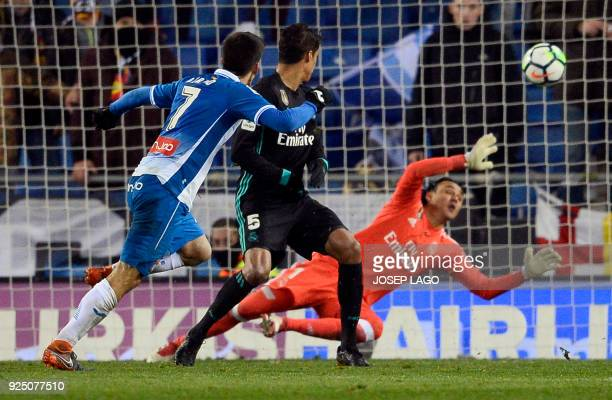 Espanyol's Spanish forward Gerard Moreno scores a goal during the Spanish league football match between RCD Espanyol and Real Madrid CF at the RCDE...