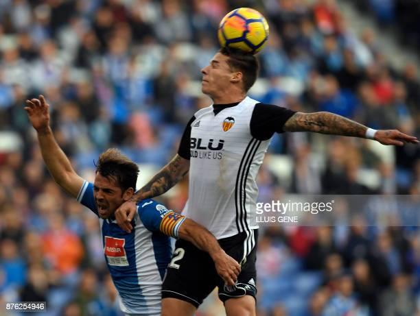 Espanyol's Spanish midfielder Victor Sanchez vies with Valencia's Spanish forward Santiago Mina Lorenzo during the Spanish league football match RCD...