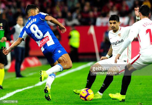 Espanyol's Venezuelan defender Roberto Rosales vies with Sevilla's Argentinian midfielder Ever Banega during the Spanish league football match...