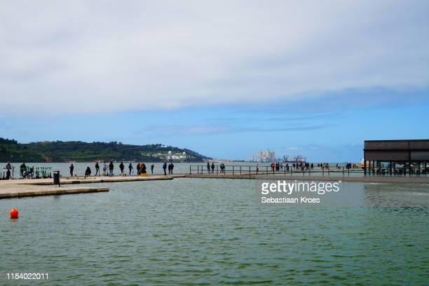 espelho de água pond and tagus river, belém, lisbon, portugal - água stock pictures, royalty-free photos & images