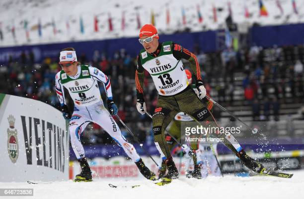 Espen Andersen of Norway and Eric Frenzel of Germany compete in the Men's Nordic Combined 10KM Cross Country during the FIS Nordic World Ski...