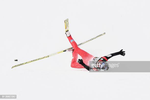 Espen Bjoernstad of Norway crashes upon landing in the Individual Gundersen LH/10km during day two of the FIS Nordic Combined World Cup Hakuba on...