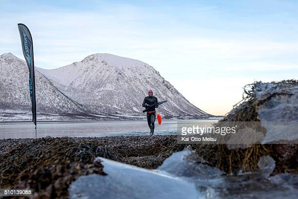Espen Moe was first out of the water on February 13 2016 in Svolvar Norway Athletes choose to swim in a drysuit due to the cold water in the fjord...