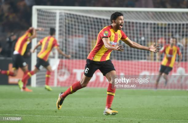 Esperance de Tunis defender Mohamed Ali Yaccoubi celebrates after scoring during the 2nd leg of CAF champion league final 2019 football match between...