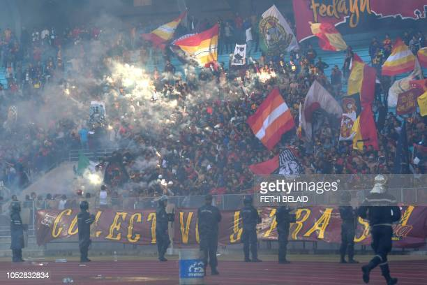 Esperance de Tunis fans cheer for their team during the CAF Champions League semifinal football match between Tunisia's ES Tunis and Angola's...