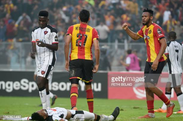 Esperance de Tunis forward Foussiny Colibaly jubilates with Mohamed Yacoubi after scoring the CAF Champions League semifinal football match between...