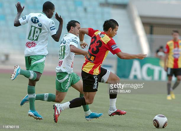 Esperance de Tunis forward Khaled Korbi vies with Hammamlif FC players Mohamed Harran and Ben Chouikha during the last day of the Tunisian major...