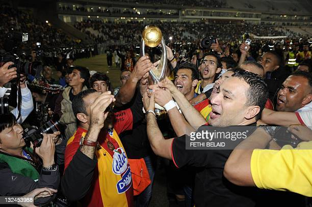 Esperance de Tunis players celebrate with the trophy after beating Morocco's WA Casablanca on November 12 2011 during their Africa Champion league...