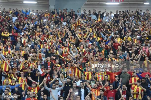 Esperance de Tunis supporters react during the 2nd leg of CAF champion league final 2019 football match between Tunisia's Esperance sportive de Tunis...