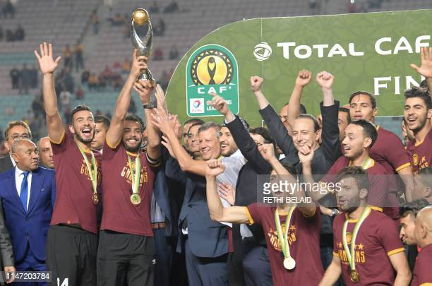 Esperance de Tunis team captain Moez Ben Cherifia holds a trophy after winning during the 2nd leg of CAF champion league final 2019 football match...
