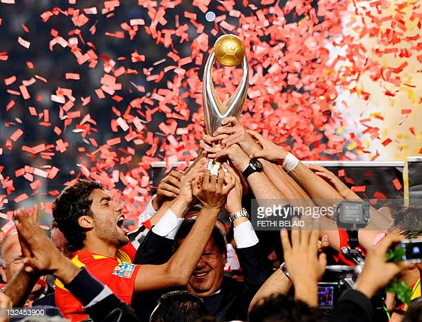 Esperance de Tunis Team captain Oussama Darragi celebrates with the trophy after beating Morocco's WA Casablanca on November 12, 2011 during their...
