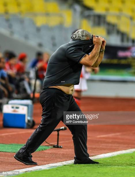 Esperance of Tunis' head coach Faouzi Benzarti reacts during the CAF Champions League quarterfinal firstleg football match between Egypt's AlAhly and...