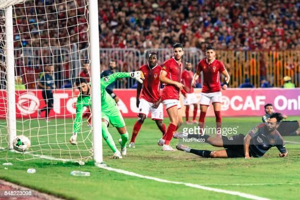 Esperance player Taha Elakhnasi scores first goal during the CAF Champions League quarterfinal firstleg football match between Egypt's AlAhly and...