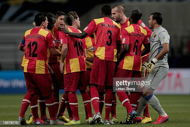 Esperance Sportive team discussing tactics before the FIFA Club World Cup 5th Place match between Club de Futbol Monterrey and Esperance Sportive de...