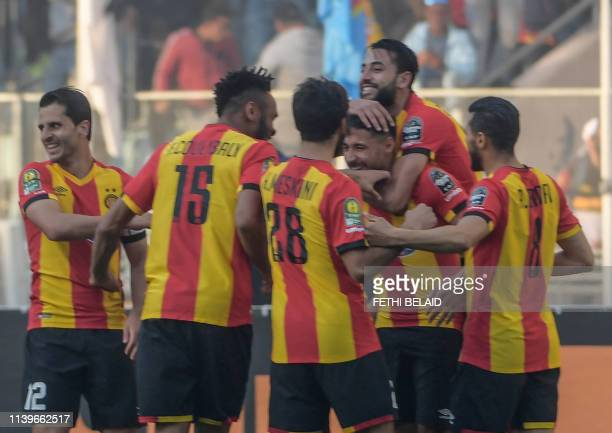 Esperance's forward Youssef Belaili celebrates his goal with teammates during the first leg of the CAF champions league semi final football match...