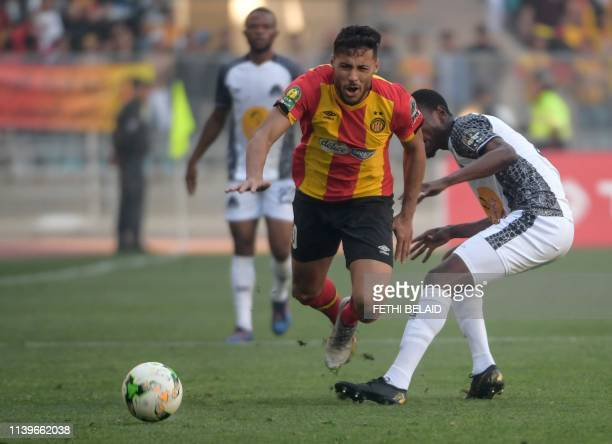Esperance's forward Youssef Blaili fights for the ball with TP Mazembe's defender Arsene Zola during the first leg of the CAF champions league semi...