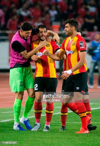 Esperance's players celebrate a goal during the CAF champion league final 2019 1st leg football match between Morocco's Wydad Athletic Club and...