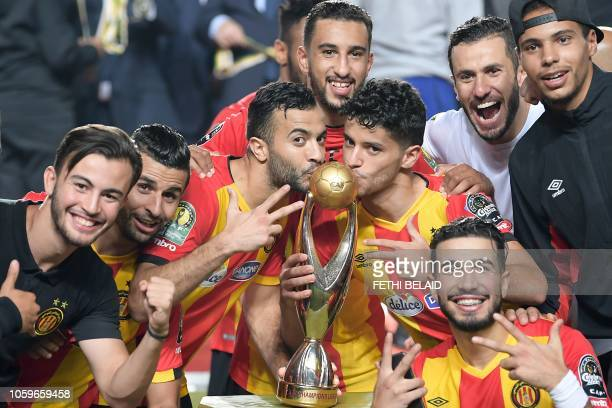TOPSHOT Esperance's players kiss the trophy after winning the CAF Champions League second leg final football match between Egypt's AlAhly and...