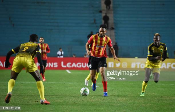Esperanc's Player Fousseny Coulibaly and AS V.club player Ernest Luzolo Sita are seen in action during the CAF Champions League 2019 - 20 football...