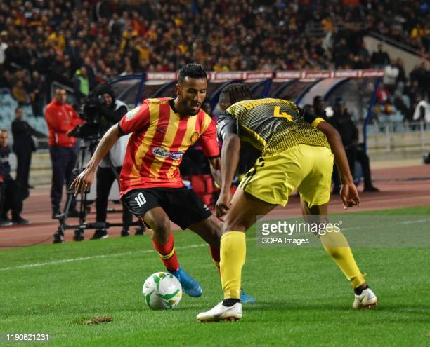 Esperanc's Player Hamdou El Houni and AS Vclub player Yannick Bangala Litombo are seen in action during the CAF Champions League 2019 20 football...