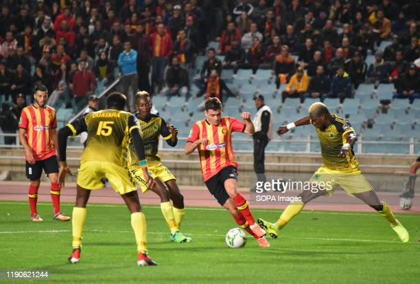 Esperanc's Player Llyess Chatti and AS V club player Ouatara Osmane are seen in action during the CAF Champions League 2019 20 football match between...