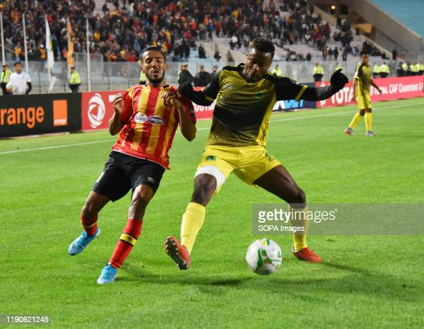 Esperanc's Players Hamdou El Houuni and AS V Club player Ernest Luzolo Sita are seen in action during the CAF Champions League 2019 - 20 football...