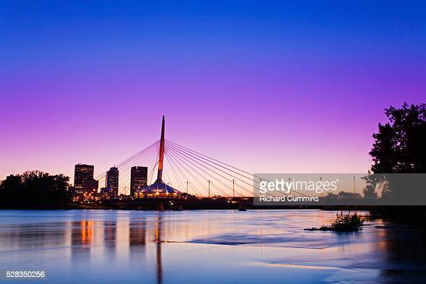 esplanade riel bridge over the red river, winnipeg, manitoba, canada - esplanade riel stock photos and pictures