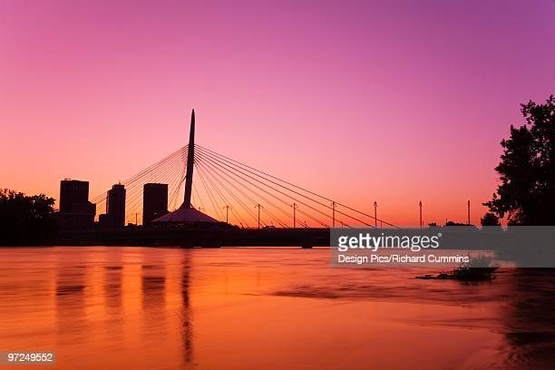 esplanade riel bridge, red river, winnipeg, manitoba, canada - esplanade riel stock photos and pictures